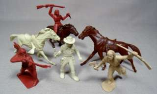 Set of 7 vintage Marx cowboy, Indian, and horses play set toy figures